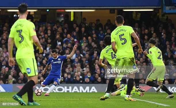 Pedro of Chelsea scores his sides first goal during The Emirates FA Cup Third Round match between Chelsea and Peterborough United at Stamford Bridge...