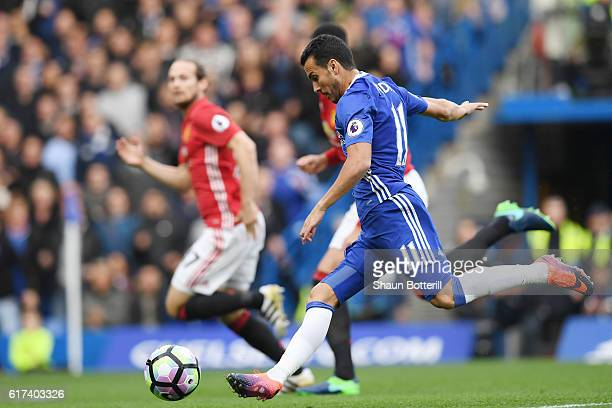 Pedro of Chelsea scores his sides first goal during the Premier League match between Chelsea and Manchester United at Stamford Bridge on October 23...