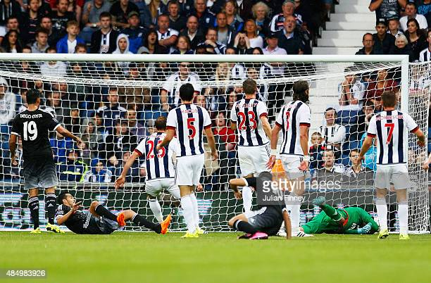 Pedro of Chelsea scores the opening goal during the Barclays Premier League match between West Bromwich Albion and Chelsea at The Hawthorns on August...