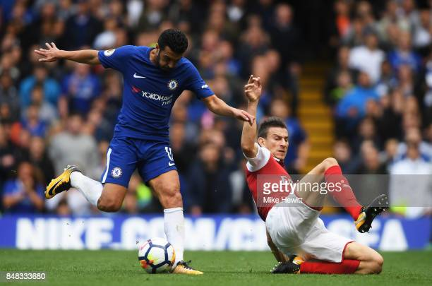 Pedro of Chelsea shoots as Laurent Koscielny of Arsenal attempts to tackle during the Premier League match between Chelsea and Arsenal at Stamford...