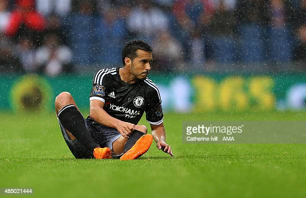 Pedro of Chelsea sits on the pitch during the Barclays Premier League match between West Bromwich Albion and Chelsea on August 23 2015 in West...