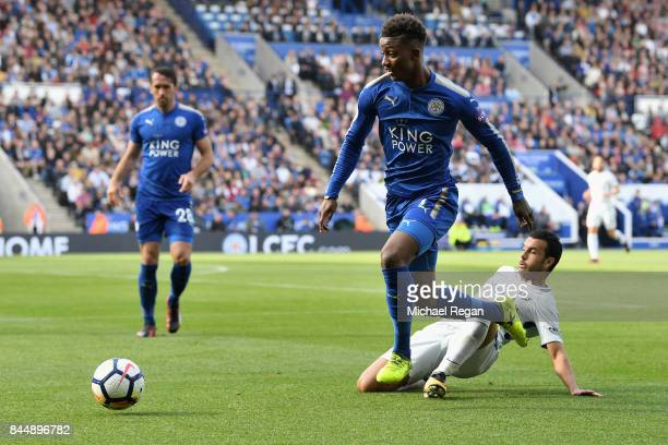 Pedro of Chelsea tackles Demarai Gray of Leicester City during the Premier League match between Leicester City and Chelsea at The King Power Stadium...