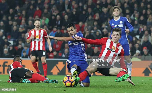 Pedro of Chelsea vies with Donald Love of Sunderland during the Premier League match between Sunderland and Chelsea at Stadium of Light on December...