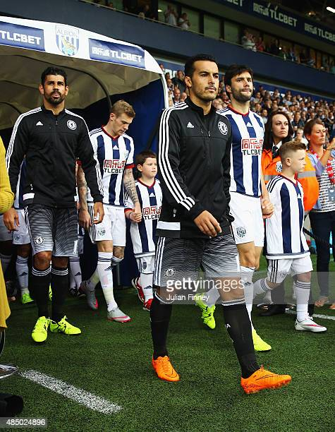 Pedro of Chelsea walks out with Diego Costa during the Barclays Premier League match between West Bromwich Albion and Chelsea at The Hawthorns on...