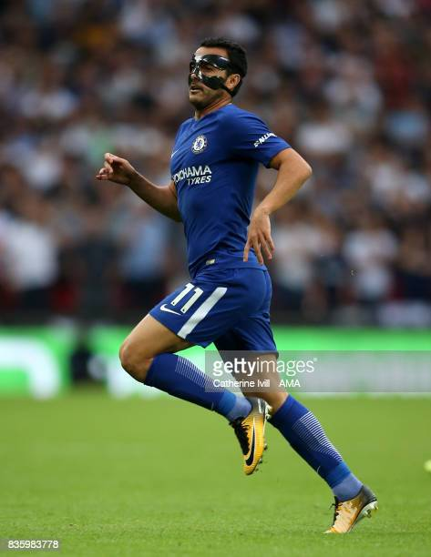 Pedro of Chelsea wearing a face mask during the Premier League match between Tottenham Hotspur and Chelsea at Wembley Stadium on August 20 2017 in...