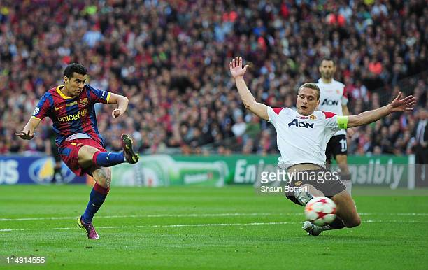 Pedro of FC Barcelona scores the opening goal during the UEFA Champions League final between FC Barcelona and Manchester United FC at Wembley Stadium...