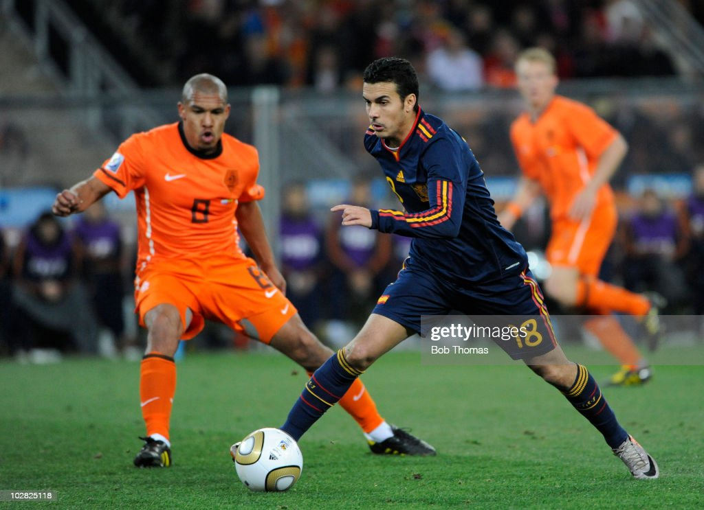 Pedro of Spain watched by Nigel De Jong of the Netherlands during the 2010 FIFA World Cup Final between the Netherlands and Spain on July 11 2010 in...
