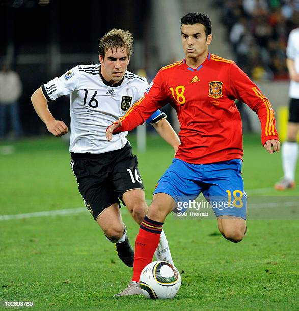 Pedro of Spain with Philipp Lahm of Germany during the 2010 FIFA World Cup South Africa Semi Final match between Germany and Spain at Durban Stadium...