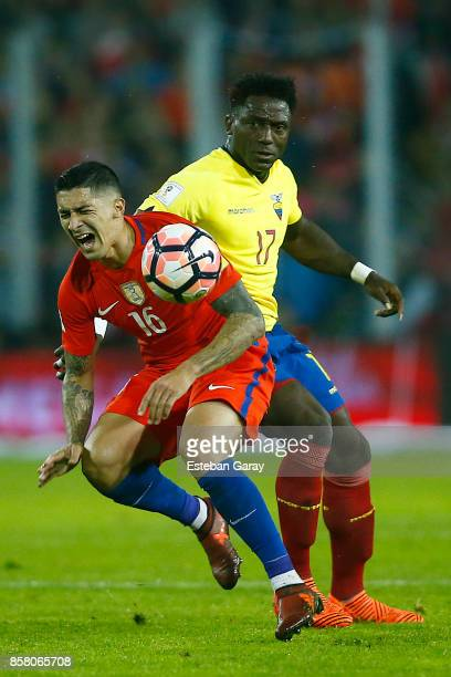Pedro Pablo Hernandez of Chile fights for the ball with Roberto Ordonez of Ecuador during a match between Chile and Ecuador as part of FIFA 2018...