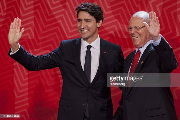 Pedro Pablo Kuczynski Peru's president right and Justin Trudeau Canada's prime minister wave to attendees during the AsiaPacific Economic Cooperation...