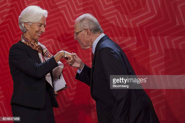 Pedro Pablo Kuczynski Peru's president right greets Christine Lagarde managing director of the International Monetary Fund during the AsiaPacific...