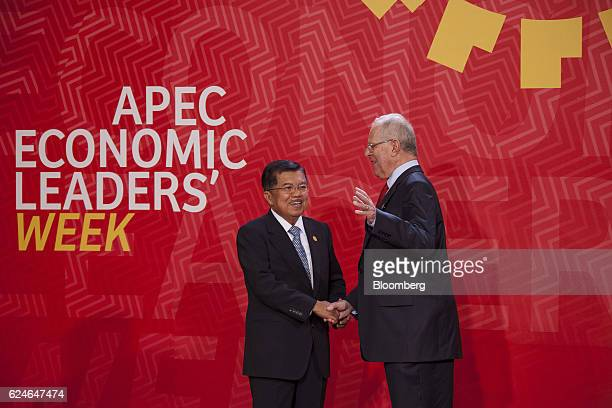 Pedro Pablo Kuczynski Peru's president right greets Jusuf Kalla Indonesia's vice president during the AsiaPacific Economic Cooperation 2016 CEO...