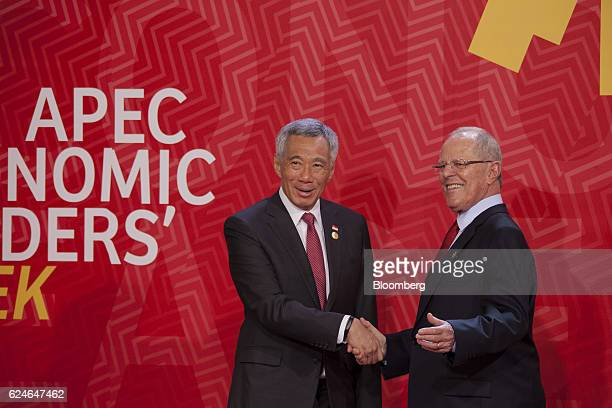 Pedro Pablo Kuczynski Peru's president right greets Lee Hsien Loong Singapore's prime minister during the AsiaPacific Economic Cooperation 2016 CEO...