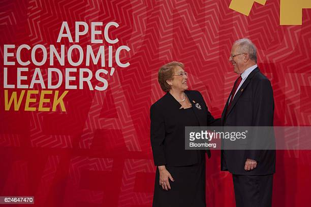 Pedro Pablo Kuczynski Peru's president right greets Michelle Bachelet Chile's president during the AsiaPacific Economic Cooperation 2016 CEO Summit...