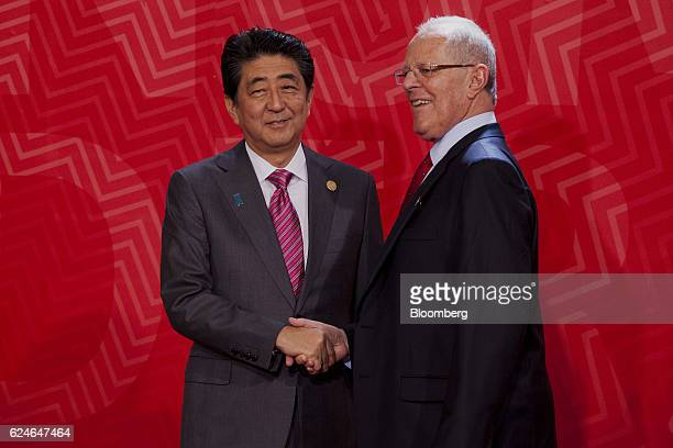 Pedro Pablo Kuczynski Peru's president right greets Shinzo Abe Japan's prime minister during the AsiaPacific Economic Cooperation 2016 CEO Summit in...