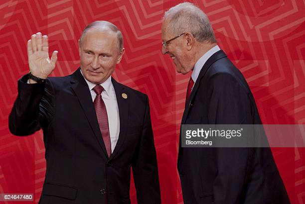 Pedro Pablo Kuczynski Peru's president right greets Vladimir Putin Russia's president during the AsiaPacific Economic Cooperation 2016 CEO Summit in...