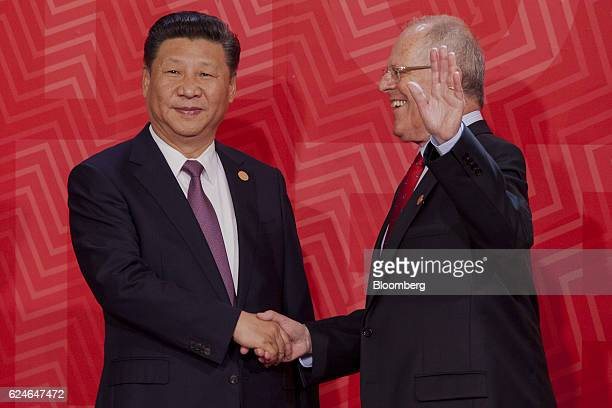 Pedro Pablo Kuczynski Peru's president right greets Xi Jinping China's president during the AsiaPacific Economic Cooperation 2016 CEO Summit in Lima...