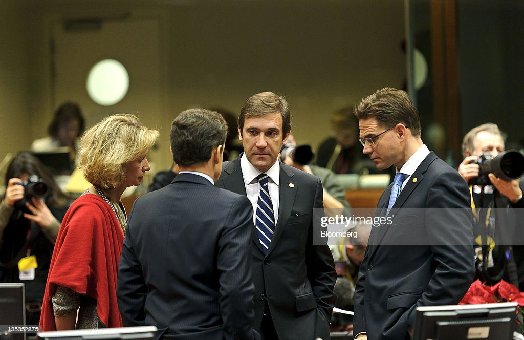 Pedro Passos Coelho, Portugal's prime minister, center, speaks with <a gi-track='captionPersonalityLinkClicked' href=/galleries/search?phrase=Nicolas+Sarkozy&family=editorial&specificpeople=211375 ng-click='$event.stopPropagation()'>Nicolas Sarkozy</a>, France's president, left and <a gi-track='captionPersonalityLinkClicked' href=/galleries/search?phrase=Jyrki+Katainen&family=editorial&specificpeople=3014648 ng-click='$event.stopPropagation()'>Jyrki Katainen</a>, Finland's prime minister, right, ahead of the summit of European Leaders at the European Council headquarters in Brussels, Belgium, on Friday, Dec. 9, 2011. European leaders added 200 billion euros ($267 billion) to their crisis-fighting warchest and tightened anti-deficit rules, seeking to lure the European Central Bank into stepping up its rescue operations.Photographer: Jock Fistick/Bloomberg via Getty Images