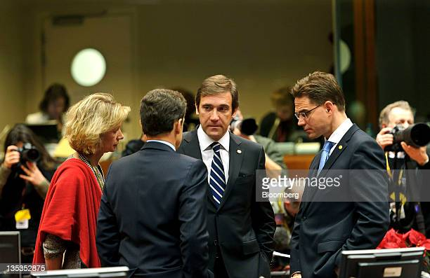 Pedro Passos Coelho Portugal's prime minister center speaks with Nicolas Sarkozy France's president left and Jyrki Katainen Finland's prime minister...