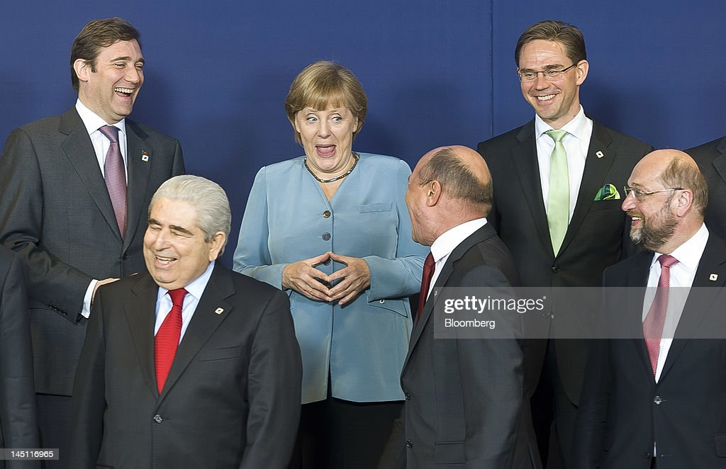 Pedro Passos Coelho, Portugal's prime minister, left to right, Dimitris Christofias, president of Cyprus, <a gi-track='captionPersonalityLinkClicked' href=/galleries/search?phrase=Angela+Merkel&family=editorial&specificpeople=202161 ng-click='$event.stopPropagation()'>Angela Merkel</a>, Germany's chancellor, <a gi-track='captionPersonalityLinkClicked' href=/galleries/search?phrase=Traian+Basescu&family=editorial&specificpeople=542324 ng-click='$event.stopPropagation()'>Traian Basescu</a>, Romania's president, <a gi-track='captionPersonalityLinkClicked' href=/galleries/search?phrase=Jyrki+Katainen&family=editorial&specificpeople=3014648 ng-click='$event.stopPropagation()'>Jyrki Katainen</a>, Finland's prime minister, and Martin Schultz, president of the European Parliament, gather for a family photograph during the European Leaders (EU) summit at the European Council headquarters in Brussels, Belgium, on Wednesday, May 23, 2012. The summit, the 18th since Greece was convulsed by debt and the first since an anti-austerity campaign carried Hollande to France's presidency, takes place with market indicators showing mounting stress on banks. Photographer: Jock Fistick/Bloomberg via Getty Images