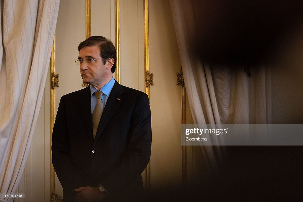 <a gi-track='captionPersonalityLinkClicked' href=/galleries/search?phrase=Pedro+Passos+Coelho&family=editorial&specificpeople=6912340 ng-click='$event.stopPropagation()'>Pedro Passos Coelho</a>, Portugal's prime minister of State, stands during a swearing in ceremony for new government ministers in Lisbon, Portugal, on Tuesday, July 2, 2013. Portugal said Secretary of State for Treasury Maria Luis Albuquerque will replace Vitor Gaspar as Finance Minister two years after the government took office. Photographer: Mario Proenca/Bloomberg via Getty Images