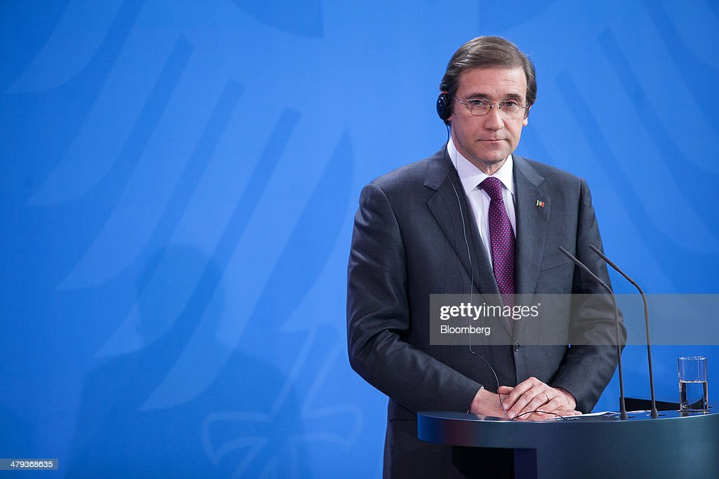 <a gi-track='captionPersonalityLinkClicked' href=/galleries/search?phrase=Pedro+Passos+Coelho&family=editorial&specificpeople=6912340 ng-click='$event.stopPropagation()'>Pedro Passos Coelho</a>, Portugal's prime minister, pauses during a news conference at the Chancellery in Berlin, Germany, on Tuesday, March 18, 2014. Coelho said on March 12 that his country had accumulated such a debt load that 'it's clear that it will be tough to pay it.' Photographer: Krisztian Bocsi/Bloomberg via Getty Images