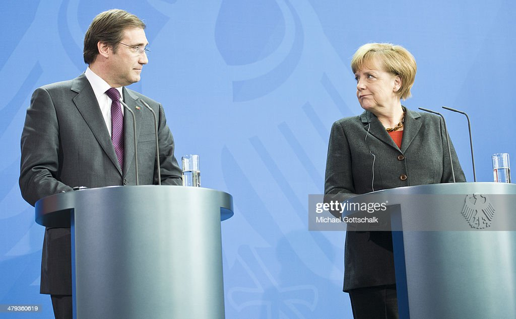 Pedro Passos Coelho, Prime Minister of Portugal, and German Chancellor Angela Merkel attend a press conference on March 18, 2014 in Berlin, Germany. After meeting with the Portuguese Prime Minister, Merkel praised Portugal's reform efforts since the European financial crisis.
