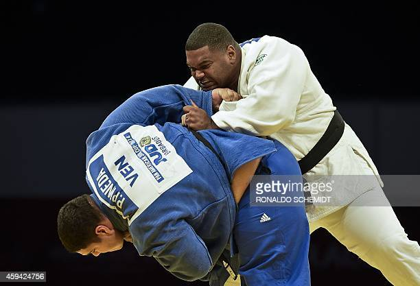 Pedro Pineda from Venezuela and Cuban Oscar Brayson face each other during the men's over 100 kgs Judo competition at the XXII Central American and...