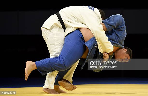 Pedro Pineda from Venezuela and Cuban Oscar Brayson struggle during the men's over 100 kgs Judo competition at the XXII Central American and...