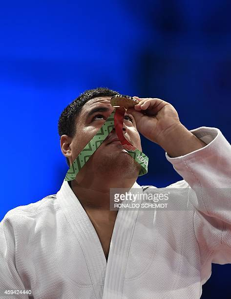 Pedro Pineda from Venezuela celebrates on the podium after winning the Gold medal against Cuban Oscar Brayson in the men's over 100 kgs Judo...