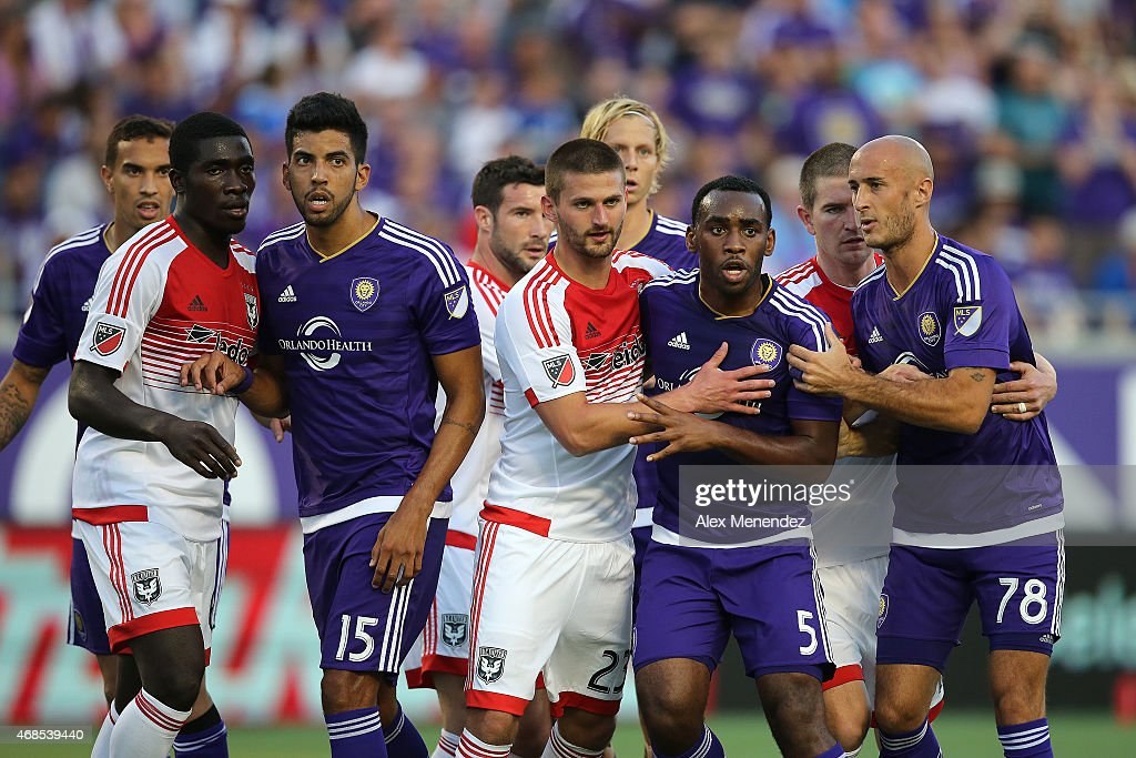 Pedro Ribeiro #15 of Orlando City FC, Perry Kitchen #23 of DC United, Amobi Okugo #5 of Orlando City FC and Aurelien Collin #78 of Orlando City FC line up for a free kick during a MLS soccer match at the Orlando Citrus Bowl on April 3, 2015 in Orlando, Florida.