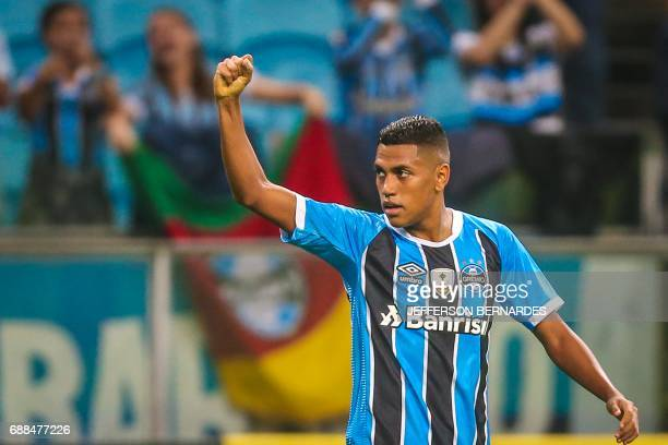 Pedro Rocha of Brazil's Gremio celebrates after scoring against Venezuela's Zamora during their Copa Libertadores football match at the Arena do...