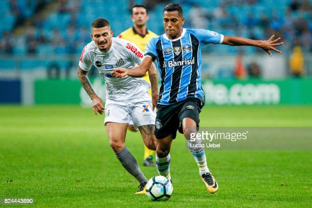 Pedro Rocha of Gremio battles for the ball against Alisson of Santos during the match Gremio v Santos as part of Brasileirao Series A 2017 at Arena...