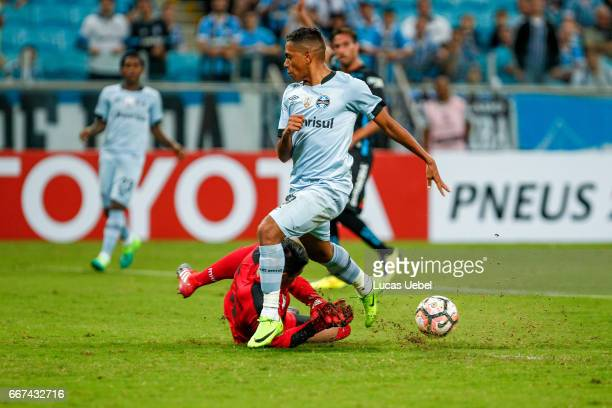 Pedro Rocha of Gremio battles for the ball against Bryan Cortes of Deportes Iquique during the match Gremio v Deportes Iquique as part of Copa...