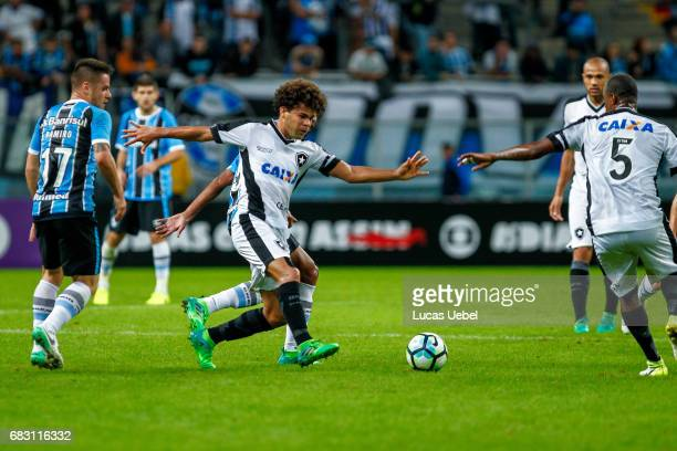 Pedro Rocha of Gremio battles for the ball against Camilo of Botafogo during the match Gremio v Botafogo as part of Brasileirao Series A 2017 at...
