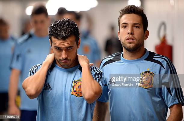 Pedro Rodríguez of Spain and Jordi Alba look on prior to the FIFA Confederations Cup Brazil 2013 Final match between Brazil and Spain at Maracana on...