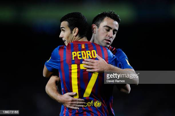 Pedro Rodriguez and Xavi Hernandez of FC Barcelona celebrates after Isaac Cuenca of FC Barcelona was is brought down by Mousa of L'Hospitalet to win...
