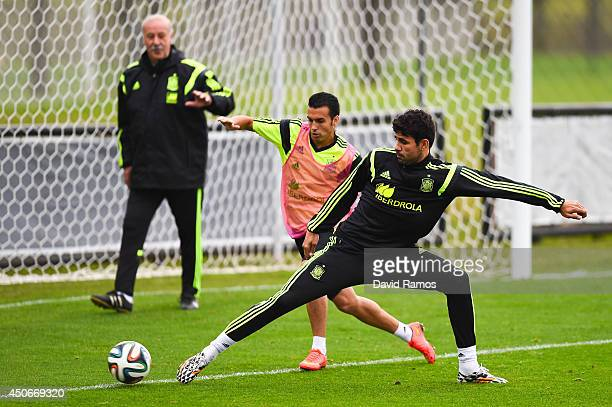 Pedro Rodriguez duels for the ball with his team mate Diego Costa during a Spain training session at Centro de Entrenamiento do Caju on June 15 2014...