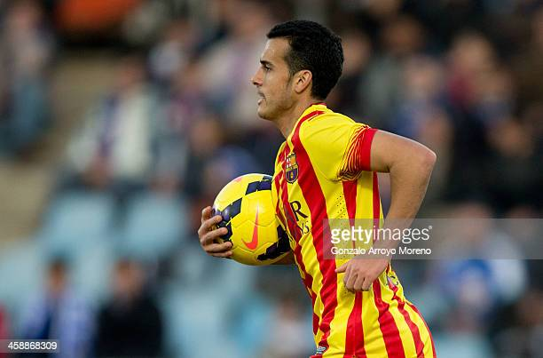 Pedro Rodriguez Ledesma of FC Barcelona celebrates scoring their opening goal during the La Liga match between Getafe CF and FC Barcelona at Coliseum...