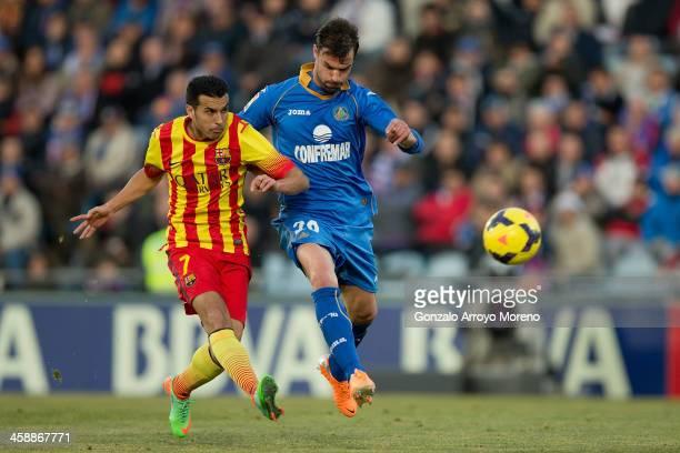 Pedro Rodriguez Ledesma of FC Barcelona scores their opening goal against Juan Valera Espin of Getafe CF during the La Liga match between Getafe CF...