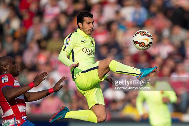 Pedro Rodriguez Ledesma of FC Barcelona wins the ball during the La Liga match between Granada CF and FC Barcelona at Nuevo Estadio de los Carmenes...