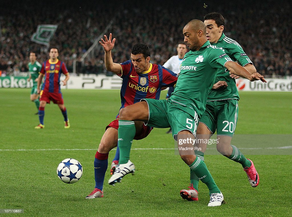 Pedro Rodriguez of Barcelona (L) battles for the ball with <a gi-track='captionPersonalityLinkClicked' href=/galleries/search?phrase=Cedric+Kante&family=editorial&specificpeople=648441 ng-click='$event.stopPropagation()'>Cedric Kante</a> (M) and Lazaros Christodoulopoulos of Panathinaikos during the UEFA Champions League Group D match between Panathinaikos FC and FC Barcelona at OAKA Spiros Louis Stadium on November 24, 2010 in Athens, Greece.
