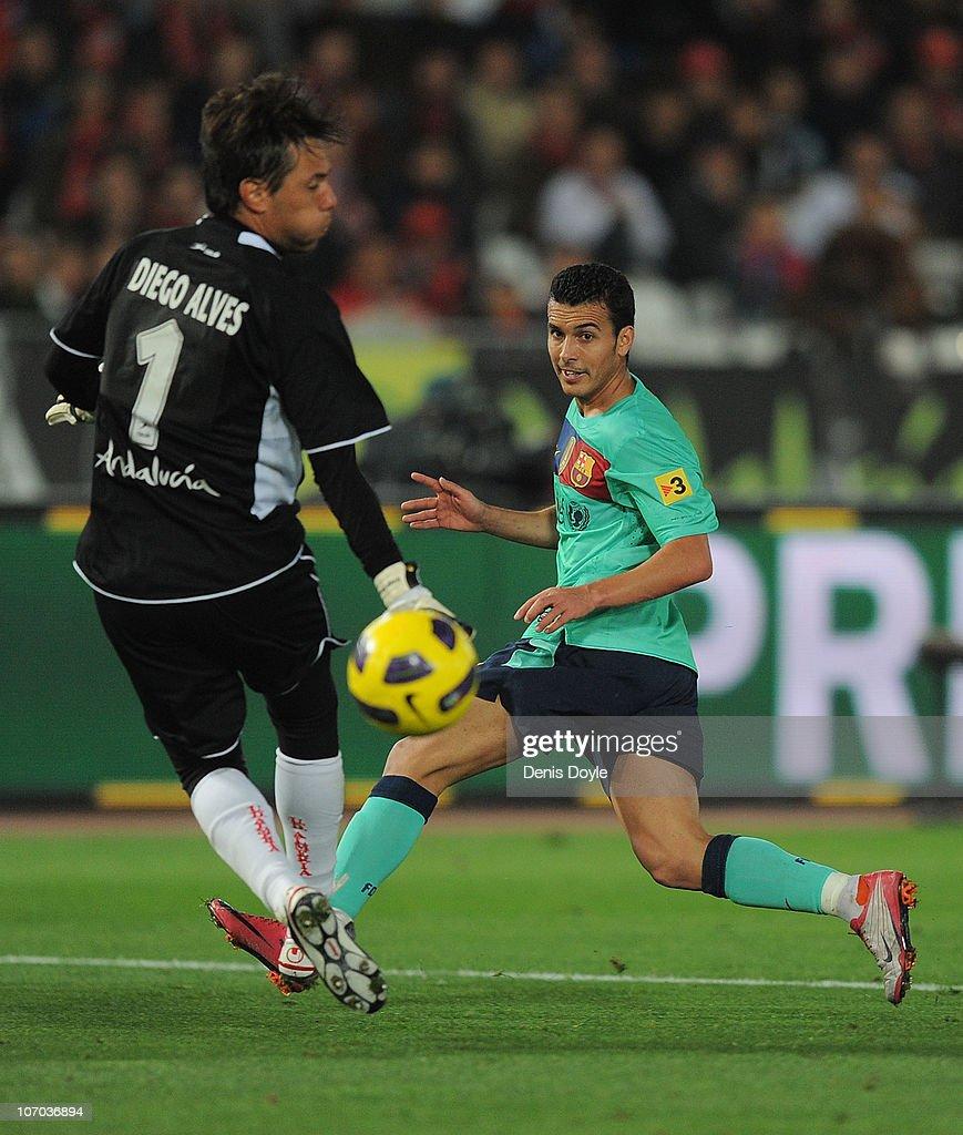Pedro Rodriguez of Barcelona beats Diego Alves of UD Almeria to score his team's fourth goal during the La Liga match between UD Almeria and Barcelona at Estadio del Mediterraneo on November 20, 2010 in Almeria, Spain.