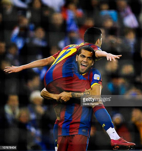 Pedro Rodriguez of Barcelona celebrates with his team mate Dani Alves after scoring his team's third goal during the La Liga match between Espanyol...
