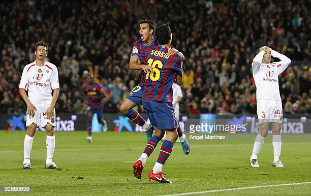 Pedro Rodriguez of Barcelona celebrates with his teammate Sergio Busquets after scoring his second goal during the La Liga match between Barcelona...