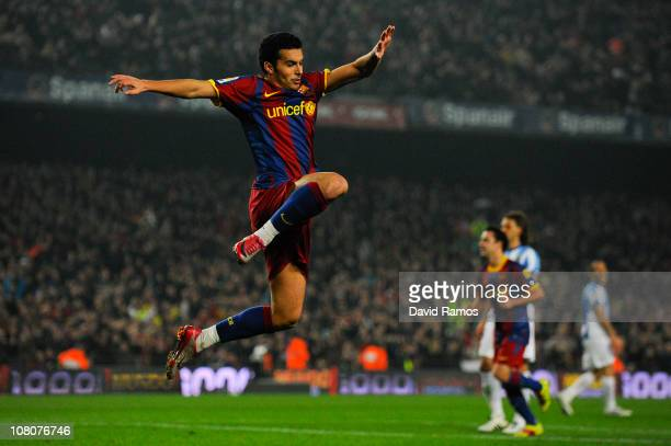 Pedro Rodriguez of FC Barcelona celebrates after scoring his side's third goal during the La Liga match between FC Barcelona and Malaga at Nou Camp...