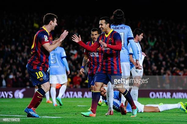 Pedro Rodriguez of FC Barcelona celebrates with his team mate Lionel Messi after scoring his team's second goal during the La Liga match between FC...