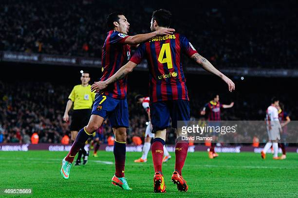 Pedro Rodriguez of FC Barcelona celebrates with his teammate Cesc Fabregas of FC Barcelona after scoring his team's fourth goal during the La Liga...