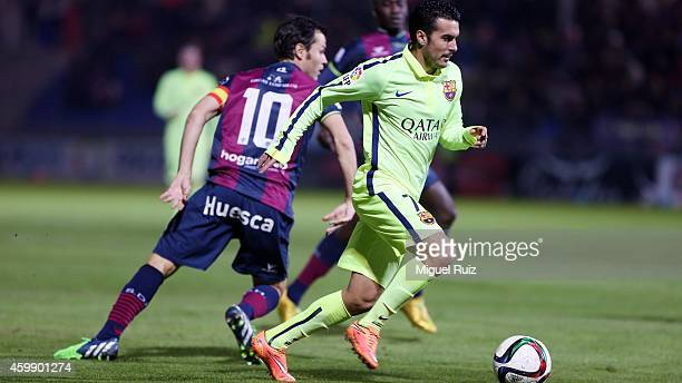 Pedro Rodriguez of FC Barcelona competes for the ball with Camacho of SD Huesca during the Copa del Rey 1/16 first leg match between SD Huesca and FC...