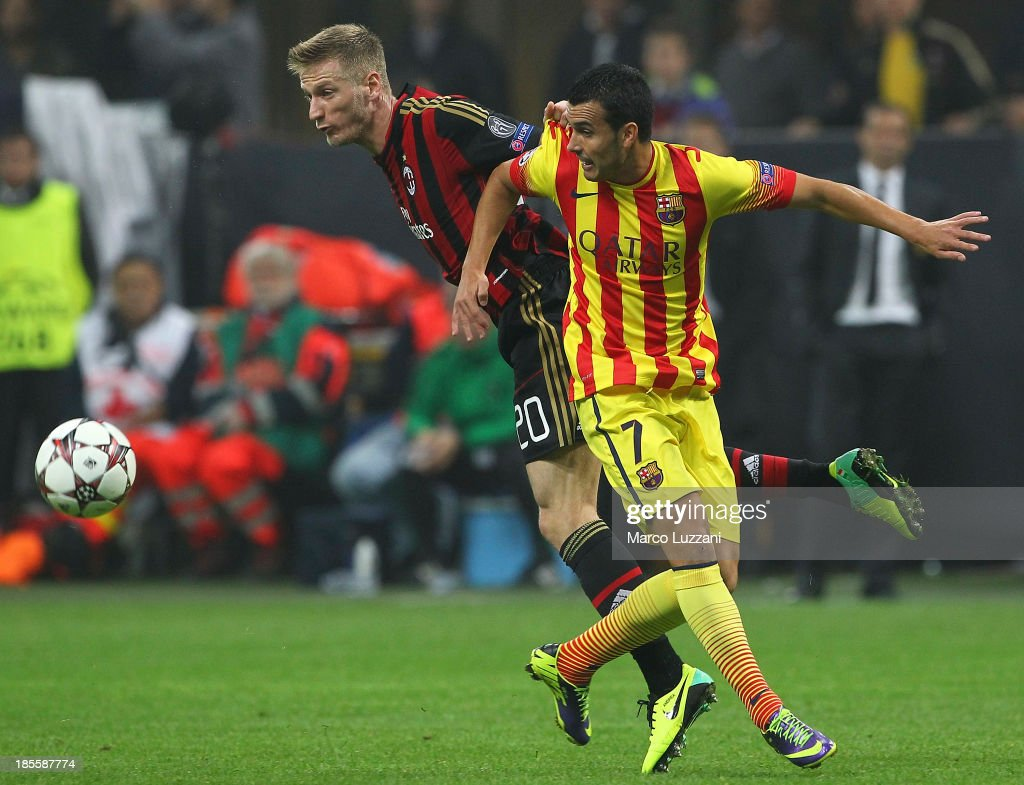 Pedro Rodriguez (R) of FC Barcelona competes for the ball with <a gi-track='captionPersonalityLinkClicked' href=/galleries/search?phrase=Ignazio+Abate&family=editorial&specificpeople=4530178 ng-click='$event.stopPropagation()'>Ignazio Abate</a> (L) of AC Milan during the UEFA Champions League Group H match between AC Milan and FC Barcelona at Stadio Giuseppe Meazza on October 22, 2013 in Milan, Italy.
